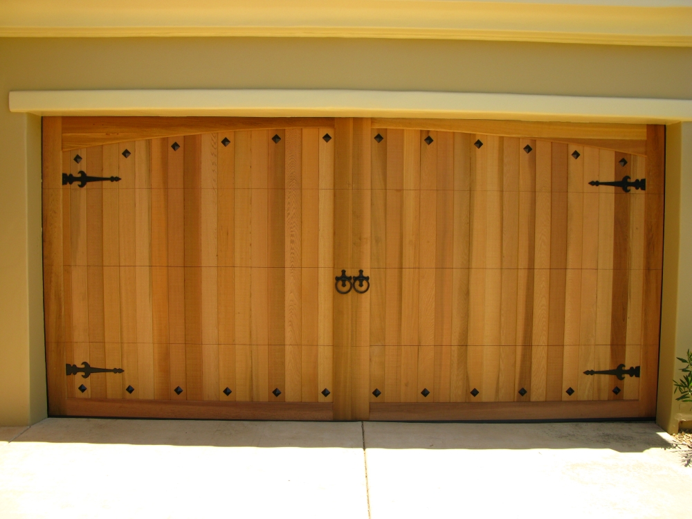 Wood garage doors garage door services nashville for Cedar wood garage doors price